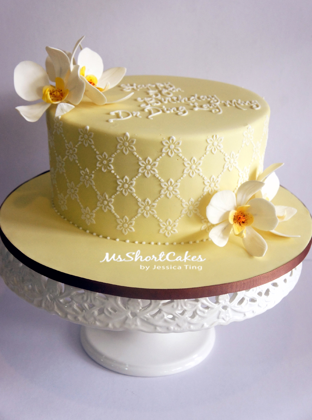 Yellow Daisies and Orchids. Cakes